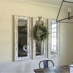 Use cheap mirrors from walmart.  Add wood around edges. Stain. Paint. Distress.  Cheap but looks expensive.