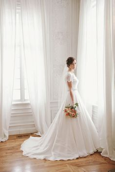 wedding dress with a ball gown skirt, short-sleeve with beaded lace scalloped sleeves
