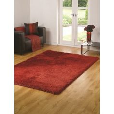 Red Shaggy Rug made from polyester. http://www.therughouse.co.uk/shaggy-rugs
