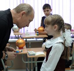 Putin looking at this little girl. | 48 Photos Of Vladimir Putin Looking At Things