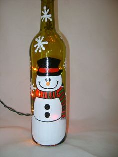 ATTENTION SNOWMAN LOVERS!!!! This recycled wine bottle has been painted with an adorable snowman and would make a beautiful piece for you to