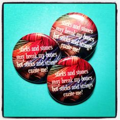 Sticks and stones my break my bones but sticks and strings excite me! 1.25 inch pinback button by Barrel of Monkeys