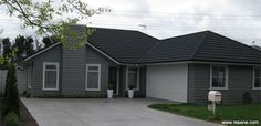 Resene Half Masala for the exterior weatherboards love the white garage door Grey Brick Houses, White Exterior Houses, Grey Exterior, House Exterior Color Schemes, Exterior Paint Colors For House, Exterior Colors, House Cladding, Facade House, House Exteriors