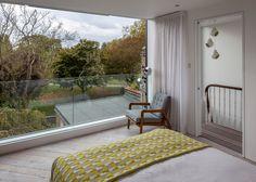 Image result for loft bedroom floor to ceiling glass doors