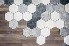 A Creative Way To Transition Between Hexagonal Tiles And Wood. You could do this with your hallway and the wine room.