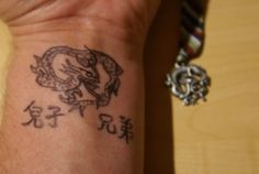 Dragon tattoo on wrist - Google Image Result for http://fc08.deviantart.net/fs29/f/2008/048/4/6/dragon_wrist_by_tattoo_your_soul.jpg