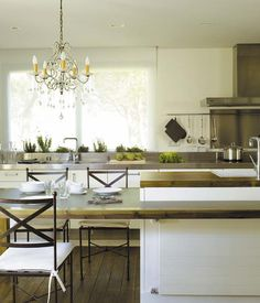 kitchen (modern rustic) with natural wood  and stainless steel accents