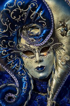 Gorgeous!  Gold and deep flue costume with a great mask.  Jewel-outlined eyes, like an exotic pair of diamond-encrusted sunglasses!