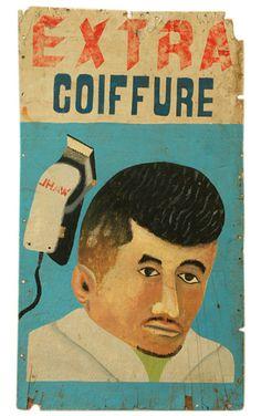 vintage Ivory Coast barbershop sign - 'Extra Coiffure.' Oil on wood panel - circa 1980's