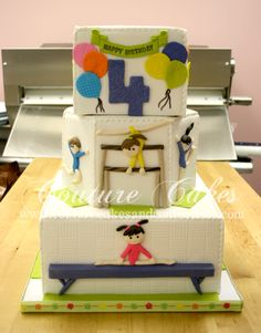Here's a 3 tier Gymnastics cake we created for a 4 year olds birthday party. We shipped it to New Jersey for one of our long time customers.