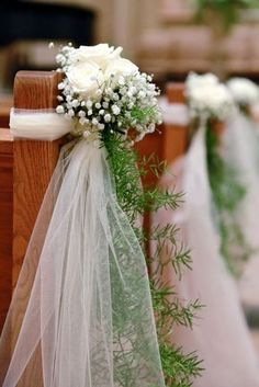 Cost effective church pew décor: Baby's breath with blush pink roses. Instead of tulle, use thick white ribbons with gold accent.