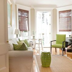 Neutral decor with green accents - love it in theory, not a fan of the window treatments and it needs a coffee table