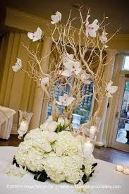 branches with blooms, this shows orchids, but using roses, alstromeria or a few others in soft pink would be dramatic