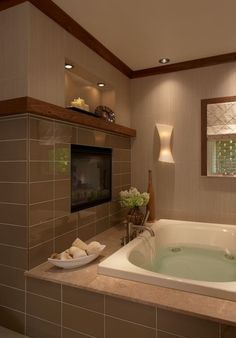 Contemporary bathroom - Jetted tub with fireplace and warm browns