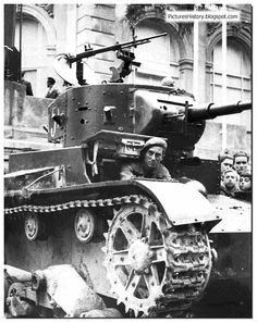 Stalin's Spain: The tanks of the rivals. A Republican soldier rides a Soviet supplied T 26 tank.