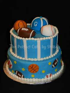 Sports baby shower - Cake for a sports-themed baby shower. Iced in buttercream, fondant football, baseball and basketball. The hat was RKT covered in fondant. I took some ideas from several cakes to make this one. Thanks to everyone for the inspiration!