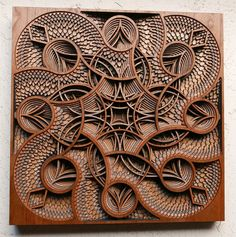 Oakland-based artist Gabriel Schama (previously) continues to produce intricate relief sculptures by layering pieces of laser-cut mahogany plywood. Some of his most impressive new works see mandala-like shapes contained within the silhouettes of people's faces, a striking idea that imbues each portr