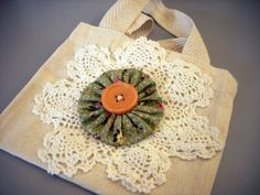 I love this mini tote with a doily, yo yo and button. Wouldn't it make a great gift bag?
