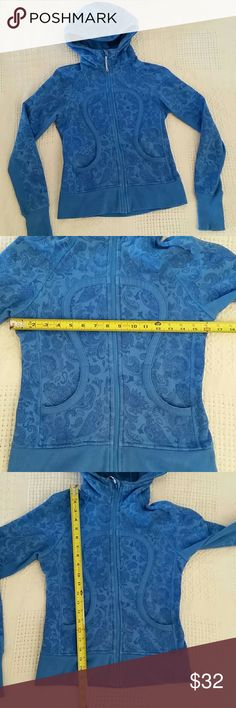 Lululemon blue Paisley full zip hoodie small Lululemon full zip hoodie, blue Paisley print, thumb holes, size tag is missing, see pics for measurements, fits like a small, pre-owned, some fading, last 2 pics shows color lululemon athletica Tops Sweatshirts & Hoodies