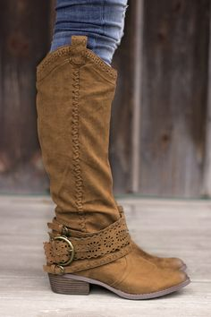 This gorgeous boot is by Not Rated. Excellent quality! Fits true to size, but if you have a wider foot, or are in between sizes we suggest order a .5 size up. Man made materials. Faux Leather. Super C