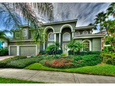 1303 Jumana Loop, Apollo Beach, FL 33572 — AWC - Taking Backup Offers	,GORGEOUS SUNSETS AWAIT YOU IN THIS STUNNING LUXURY 4 BEDROOM 3.5 BATH HOME ON THE SHORES OF TAMPA BAY.  WALK THROUGH THE BEAUTIFUL ETCHED FRONT DOORS TO THE GREAT ROOM WITH SOARING CEILINGS AND SPECTACULAR VIEWS.  THE GRAND STAIRCASE IS A FOCAL point which IS THE CENTER PIECE OF THE DINING ROOM AND GREAT ROOM. THE KITCHEN WITH WOOD CABINETS, GRANITE COUNTER-TOPS, GLASS cook top  AND STAINLESS APPLIANCES, PLUS EATING AREA…