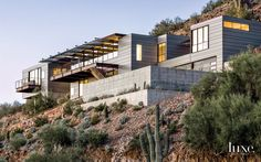A Modern Paradise Valley Marvel with Industrial-Grade Architectural Materials.The concrete-glass-and-steel structure was designed specifically for the rocky site.  --(House view photo #1 -