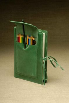 Sketchbook and pencils holding case