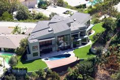 Rihanna This 8,520-square-foot Beverly Hills mansion cost Rihanna 6.9 million in 2009, but just went on sale for the low price of 4.5 million due to extensive water damage (for which, she's suing the builder). The home features all the amenities including 8 bedrooms, 10 bathrooms, a sauna, steam room, and home theater.