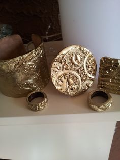 Gold variation, cuff bangle and rings