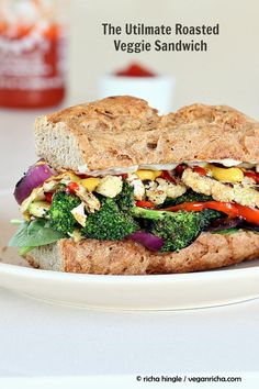 This ultimate Veggie sandwich packs the goodness of roasted veggies and loads of them, Use dressing of choice and eat up. Vegan