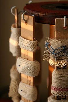 @Elizabeth Lockhart Johnson Organization? bits of ribbon and trim wound on sticks (paint stir sticks or lengths of rulers?)