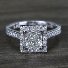 This extravagant 1.5 carat princess cut diamond engagement ring dazzles along its glittering angular halo. A delicate micro-pave band adds even more brilliance!