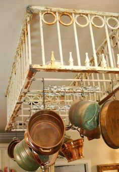 Vintage iron fencing upcycled as overhead pot rack