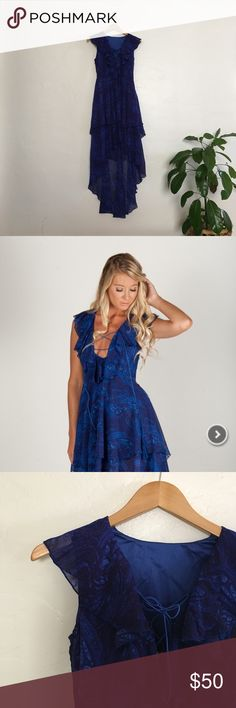 Blue Ruffle Hi-Lo Party Dress 🎉 This cobalt + navy paisley print will make a bold statement to any special occasion! Ruffles at neckline and hem are festive and flattering, but nothing beats that deep neckline w lace-up detail and tassel ties. Military Hippie Dresses High Low