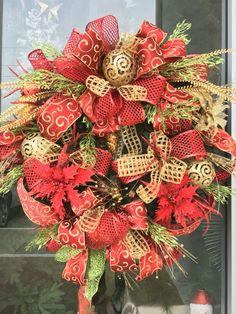 Gold and red Christmas wreath designed by Arcadia Floral & Home Decor