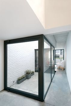A simple courtyard space that connects with the interior of the home, defined by clean lines.