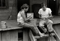 """Leatherwood, Kentucky, 1964. Willie and Vivian Cornett sitting on porch."" Willie, a recently laid off coal miner, and wife Vivian had 12 children when William Gedney snapped this exposure on his first visit with the Cornett family. Gedney Photographs and Writings Collection, Duke University."