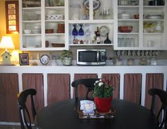 Pinner says: Made the cabinet curtains ... found    unfinished cabinets FREE on Craigs List...after a little paint and homemade curtains - they are perfect in our 1926 farm house kitchen! :)