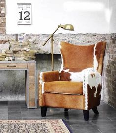 Cowhide chair. Seriously love. Cowhide is so soft under foot and easy to clean and always looks great.