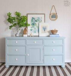 A dated knotty pine dresser gets a coastal inspired makeover with General Finishes milk paint plus a complete tutorial on how to fill old hardware holes.