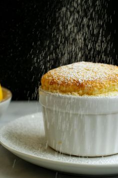 """NYT Cooking: This soufflé, adapted from Mark Bittman's famous tome, """"How to Cook Everything,"""" is rich, fluffy and very easy. You can also make orange or Grand Marnier… Lemon Souffle Recipe, Souffle Dish, Souffle Recipes Easy, Vanilla Souffle, Lemon Recipes, Sweet Recipes, Cake Recipes, Gourmet, Gastronomia"""