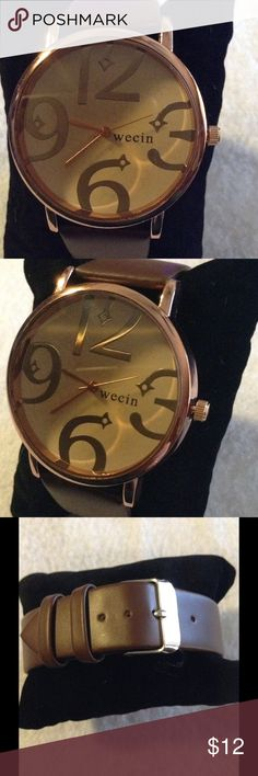 Wecin Fashion Watch Wecin fashion watch with rose gold tone face and hands.  PU leather band.  Large numbers for easy view.  Stainless steel back.  New never been worn. Wecin Accessories Watches