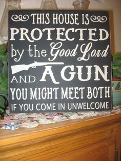 Primitive Wood Sign,Wood Sign,This House Protected by,Gun Sign,Rustic Wood Sign,Porch Decor,Porch Sign,Gun Rights sign,Wall Decor,Entry Sign by joann