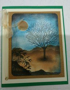 Cartão feito a mão com sobras de papeis e papeis usados.