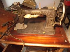 FLAT BLACK EMBOSSED WHITE ROTARY SEWING MACHINE ABOUT 1910 ?