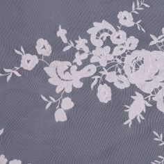 From Anna Sui, stretch ivory mesh with a large embroidered floral design. Add this to knit tops, tees and dresses as an accent fabric. Lightweight and sheer.