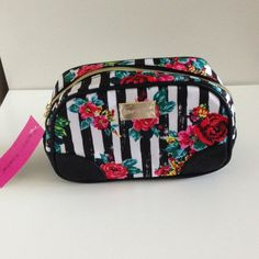 💝SALE💝Betsey Johnson Cosmetic Bag Fun Betsey Johnson cosmetic bag...black and white striped with a bright fun floral print..gold tone zipper and fun graphic sayings line the inside of this awesome makeup bag...great for travel or even everyday use...what girl couldn't use this fun bag for their makeup or other girly girl necessities!!! 💕💁💕 Betsey Johnson Accessories