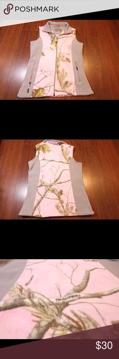 Cabela's Women's Camo Fleece Vest SMALL PINK/GREY Gently Used Excellent Condition Cabela's Women's Camo Camp Fleece Vest in SMALL. No flaws. Has a zipper front & 2 zipper pockets on the front. Grey accent panels and features the Realtree AP Print. This is normally $55 on the website. Please see all photos. Let me know if you have any questions or make me an offer. ☺️ Cabela's Jackets & Coats Vests