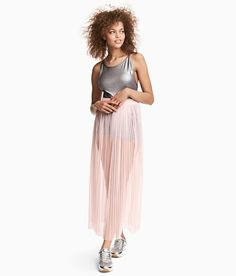 Check this out! H&M LOVES COACHELLA. Long skirt in pleated mesh with an elasticized waistband. Unlined. Made from recycled polyester. - Visit hm.com to see more.