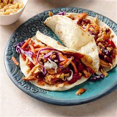 Slow Cooker Caribbean Moo Shu Chicken Recipe -A tropical twist on a takeout favorite, this slow cooker creation is simple, satisfying and destined to become a new family favorite! —Shannon Kohn, Simpsonville, South Carolina